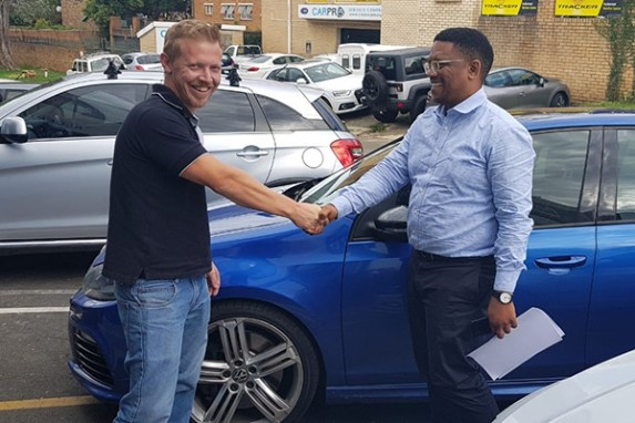 Happy customer handing over car to SellMyCar2day
